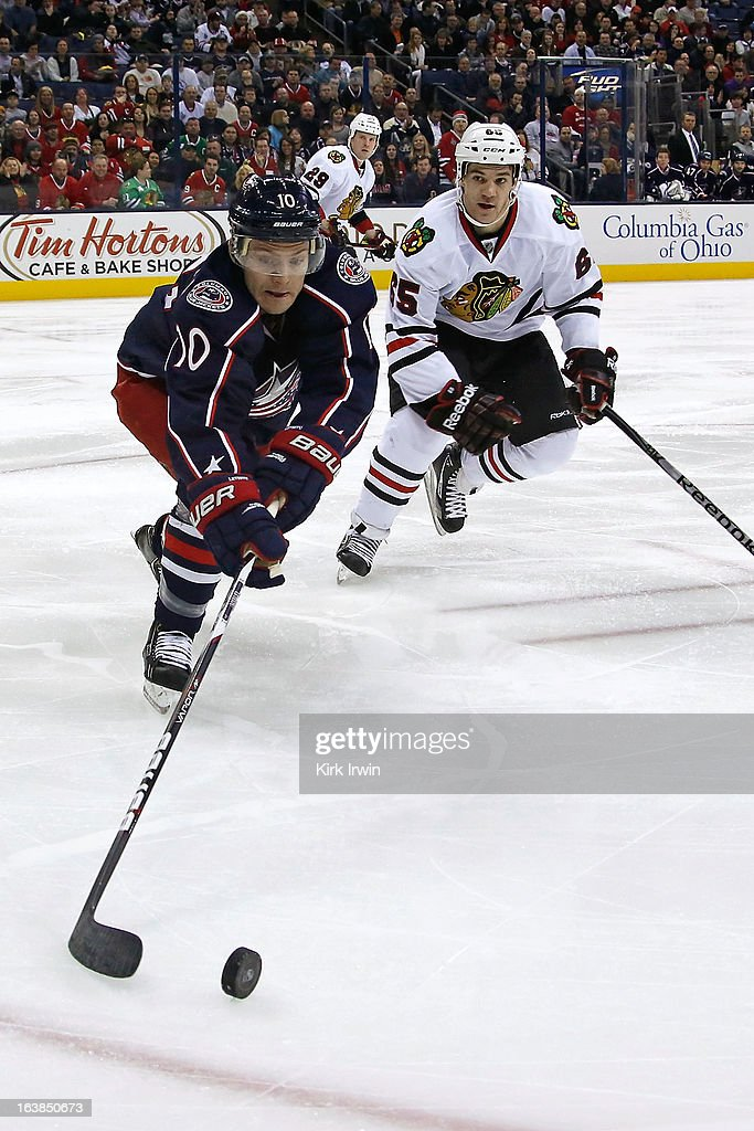 Mark Letestu #10 of the Columbus Blue Jackets and Andrew Shaw #65 of the Chicago Blackhawks chase after a loose puck on March 14, 2013 at Nationwide Arena in Columbus, Ohio.