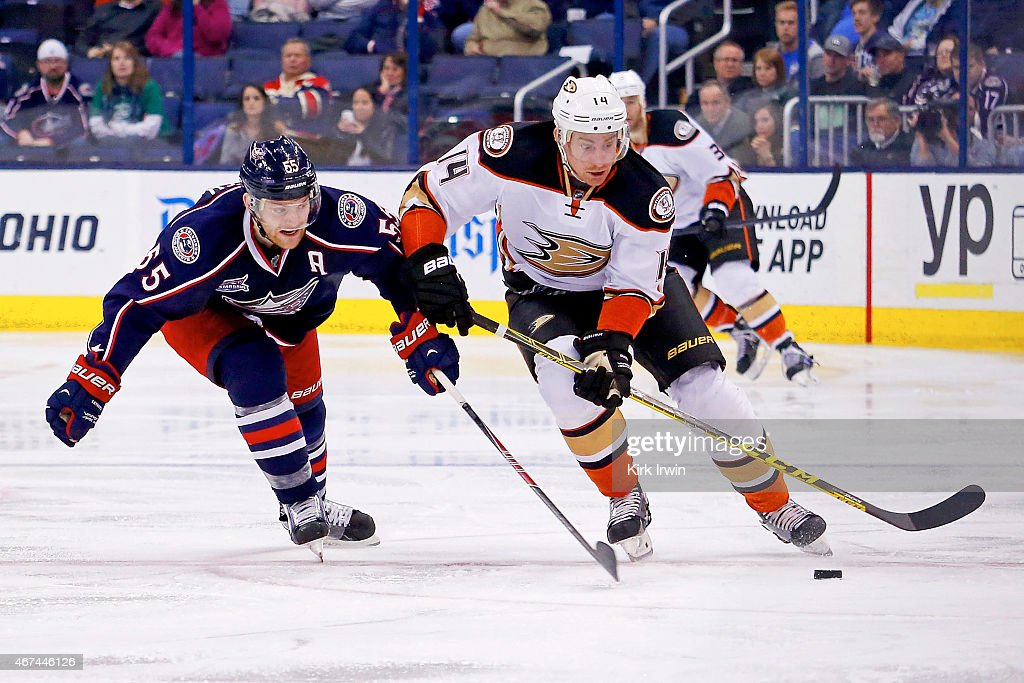 Mark Letestu of the Columbus Blue Jackets and Tomas Fleischmann of the Anaheim Ducks battle for control of the puck during the third period on March...
