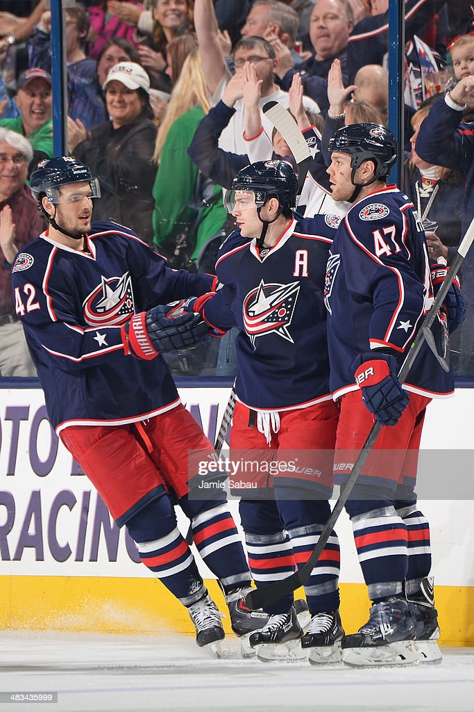 Mark Letestu #55 of the Columbus Blue Jackets celebrates his second-period goal with teammates Artem Anisimov #42 and Dalton Prout #47 during a game against the Phoenix Coyotes on April 8, 2014 at Nationwide Arena in Columbus, Ohio.
