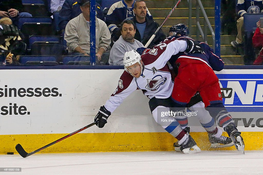 Mark Letestu #55 of the Columbus Blue Jackets checks Paul Stastny #26 of the Colorado Avalanche while chasing after the puck during the second period on April 1, 2014 at Nationwide Arena in Columbus, Ohio.
