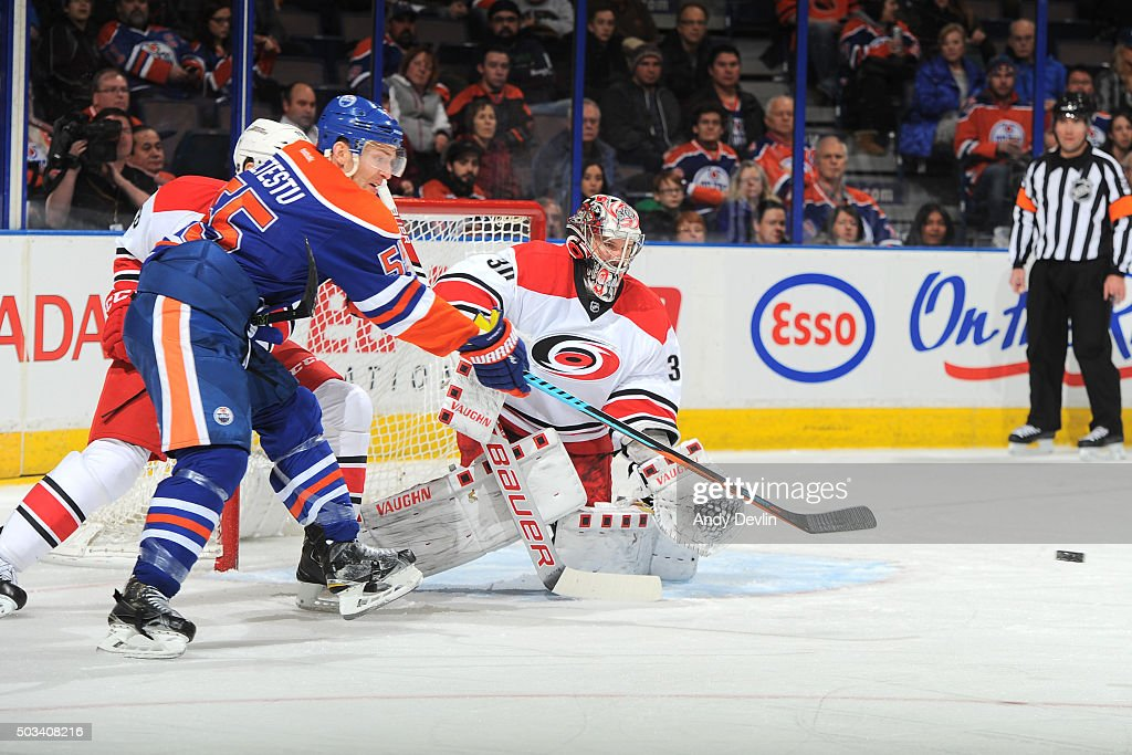 Mark Letestu of the Edmonton Oilers attempts to tip the puck as Cam Ward of the Carolina Hurricanes prepares to make the save on January 4 2016 at...