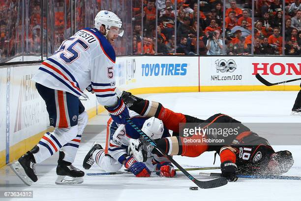 Mark Letestu of the Edmonton Oilers gains control of the puck as Andrej Sekera battles against Corey Perry of the Anaheim Ducks in Game One of the...