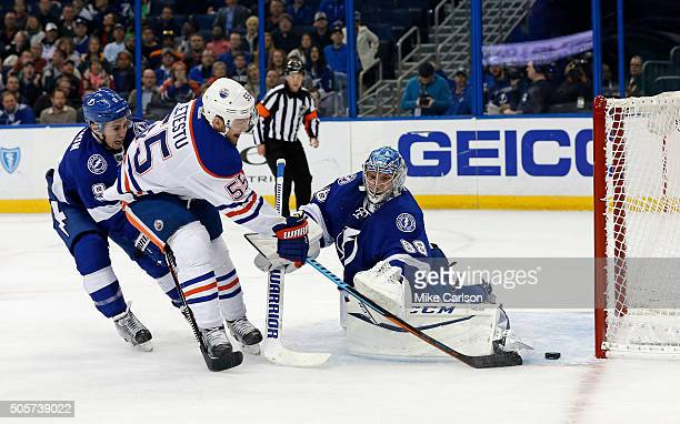 Mark Letestu of the Edmonton Oilers scores past Andrei Vasilevskiy of the Tampa Bay Lightning and the defense of Tyler Johnson at the Amalie Arena on...
