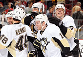 Mark Letestu of the Pittsburgh Penguins is congratulated by teammates Tyler Kennedy and Evgeni Malkin after scoring the gamewinning shootout goal...