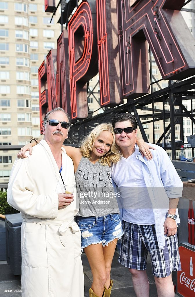 Mark Linn-Baker, Kristin Chenoweth and Michael McGrath of 'On the Twentieth Century' celebrate on the pool deck of The Empire Hotel on July 12, 2015 in New York City.
