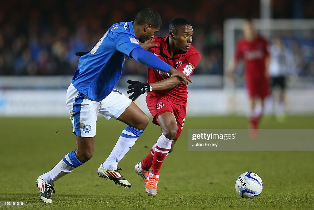 Mark Little of Peterborough battles with Callum Harriott of Charlton during the npower Championship match between Peterborough United and Charlton Athletic at London Road Stadium on March 5, 2013 in Peterborough, England.