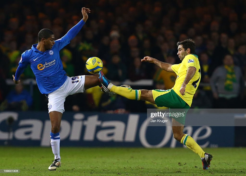 Mark Little of Peterborough United and Russell Martin of Norwich City fight for the ball during the FA Cup with Budweiser third round match between Peterborough United and Norwich City at London Road Stadium on January 5, 2013 in Peterborough, England.
