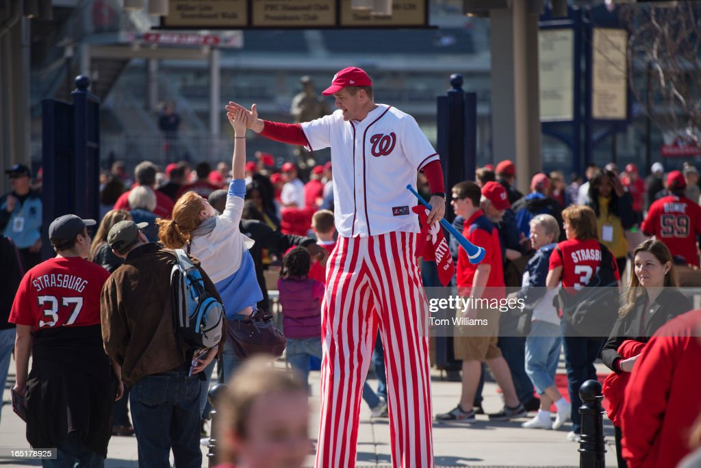 Mark Lohr, greets fans outside of Nationals Park on the team's opening game against the Miami Marlins.