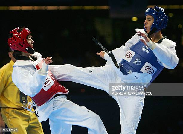 Mark Lopez of the US fights against Korean Song MyeongSeob during their men's under 67 kg final match at the Taekwondo World Championships in Madrid...