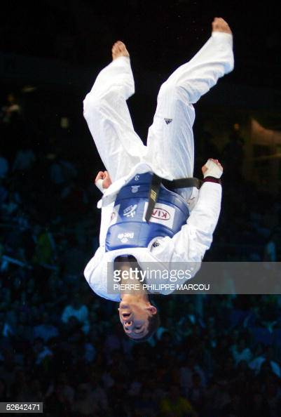 Mark Lopez of the US jumps to celebrate his victory on Korean Song MyeongSeob at the end of their men's under 67 kg final match at the Taekwondo...
