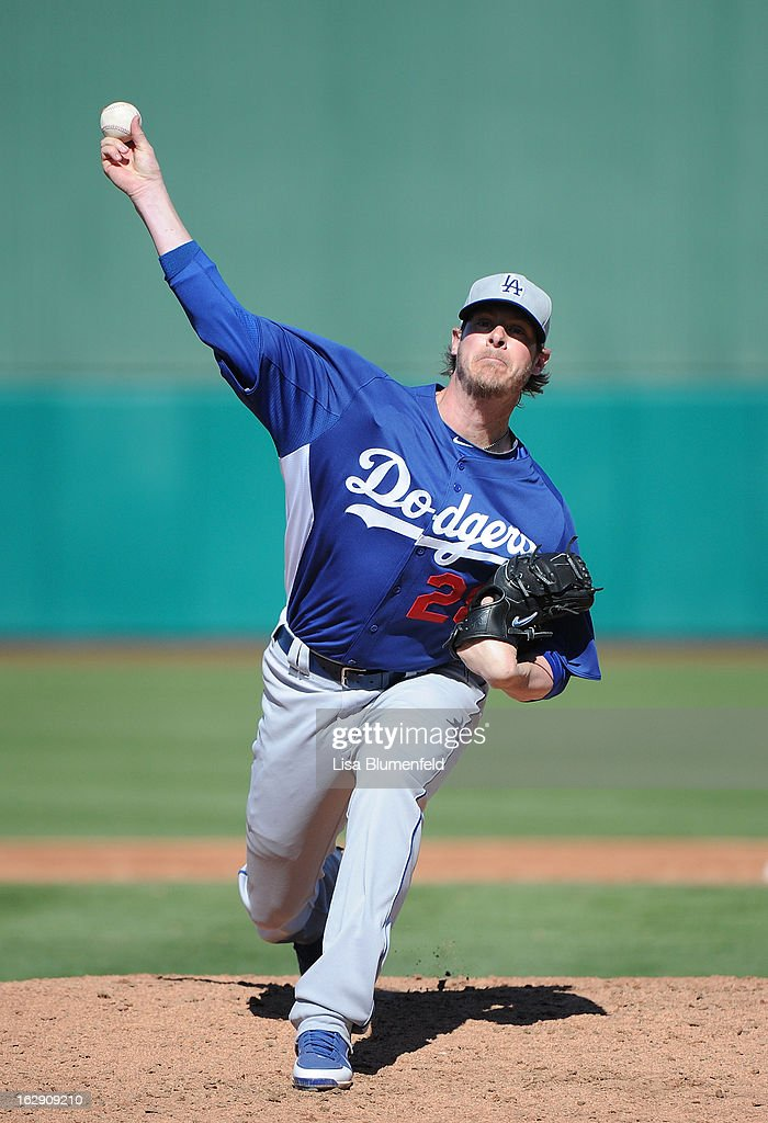 <a gi-track='captionPersonalityLinkClicked' href=/galleries/search?phrase=Mark+Lowe&family=editorial&specificpeople=753595 ng-click='$event.stopPropagation()'>Mark Lowe</a> #28 of the Los Angeles Dodgers pitches against the Chicago Cubs on February 27, 2013 at HoHoKam Park in Mesa, Arizona.