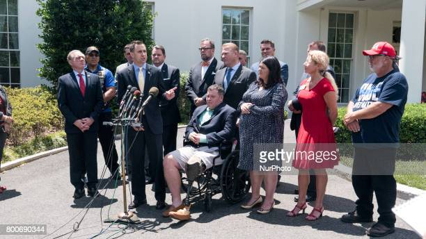 Mark Lucas Executive Director of Concerned Veterans for America surrounded by VA Secretary David J Shulkin and a group of veterans speaks to...