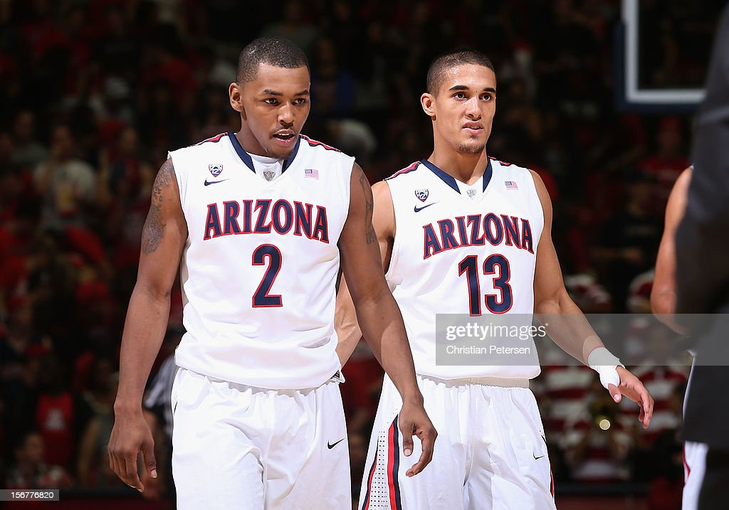 Mark Lyons #2 and Nick Johnson #13 of the Arizona Wildcats during the college basketball game against the Long Beach State 49ers at McKale Center on November 19, 2012 in Tucson, Arizona. The Wildcats defeated the 49ers 94-72.