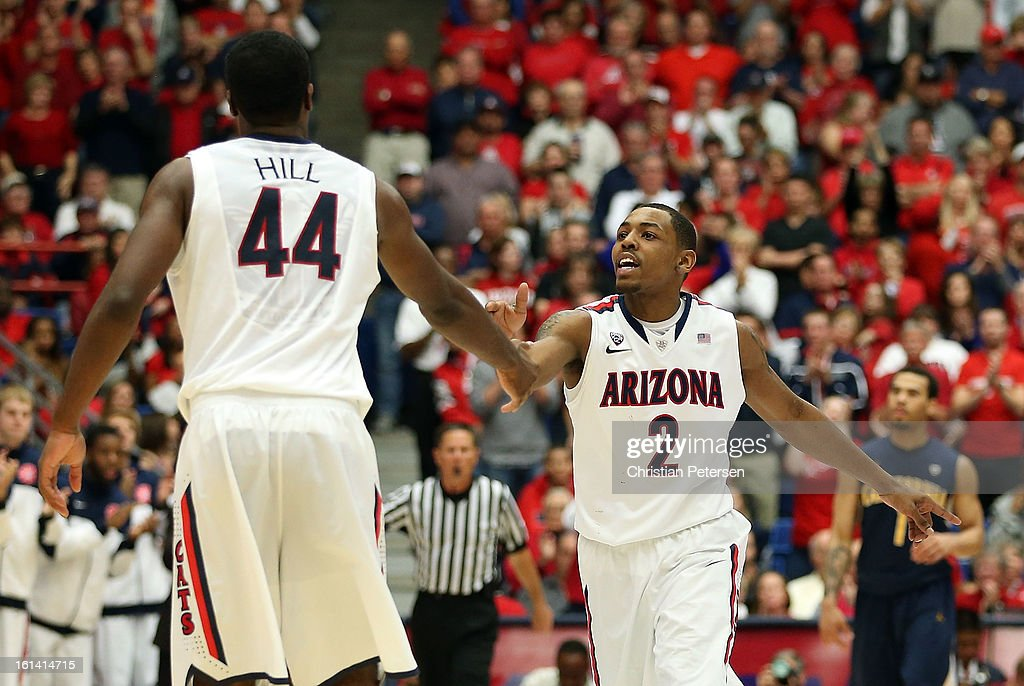 Mark Lyons #2 of the Arizona Wildcats high-fives <a gi-track='captionPersonalityLinkClicked' href=/galleries/search?phrase=Solomon+Hill&family=editorial&specificpeople=6835906 ng-click='$event.stopPropagation()'>Solomon Hill</a> #44 after hitting a three point shot against the California Golden Bears during the college basketball game at McKale Center on February 10, 2013 in Tucson, Arizona. The Golden Bears defeated the Wildcats 77-69.