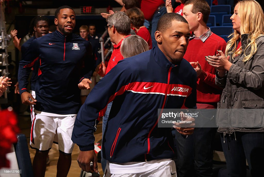 Mark Lyons #2 of the Arizona Wildcats leads teammates onto the court before the college basketball game against the Florida Gators at McKale Center on December 15, 2012 in Tucson, Arizona. The Wildcats defeated the Gators 65-64.