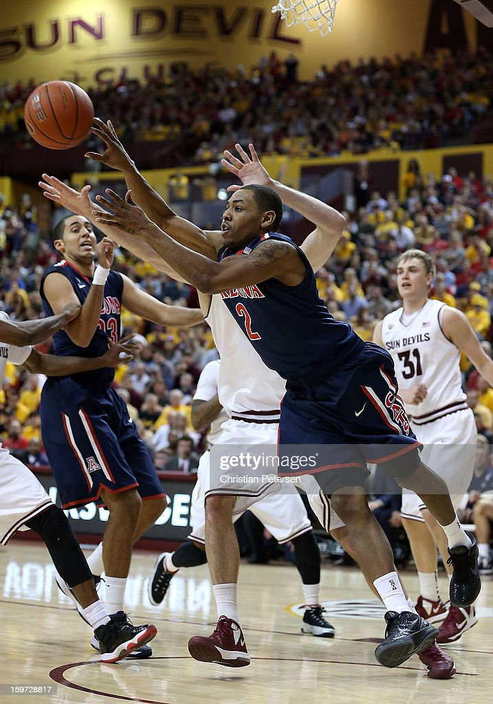 Mark Lyons #2 of the Arizona Wildcats passes the ball during the second half of the college basketball game against the Arizona State Sun Devils at Wells Fargo Arena on January 19, 2013 in Tempe, Arizona. The Wildcats defeated the Sun Devils 71-54.