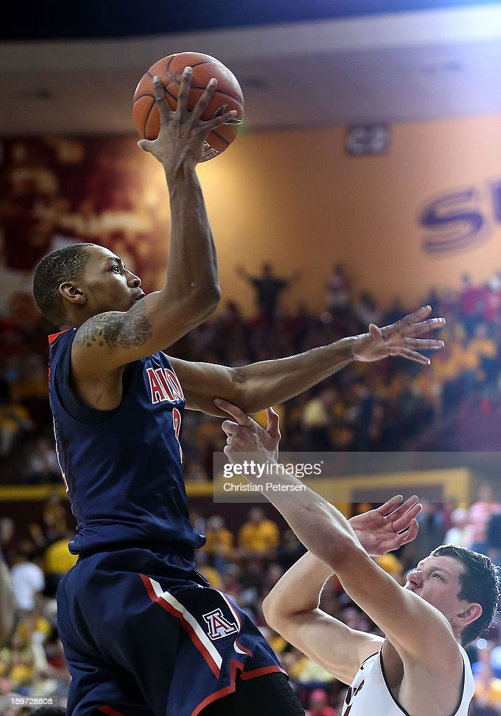 Mark Lyons #2 of the Arizona Wildcats puts up a shot against the Arizona State Sun Devils during the second half of the college basketball game at Wells Fargo Arena on January 19, 2013 in Tempe, Arizona. The Wildcats defeated the Sun Devils 71-54.