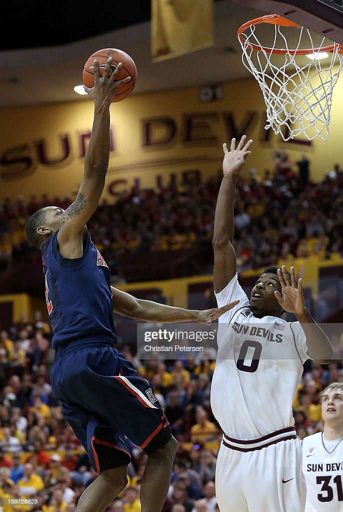 Mark Lyons #2 of the Arizona Wildcats puts up a shot over Carrick Felix #0 of the Arizona State Sun Devils during the college basketball game at Wells Fargo Arena on January 19, 2013 in Tempe, Arizona. The Wildcats defeated the Sun Devils 71-54.