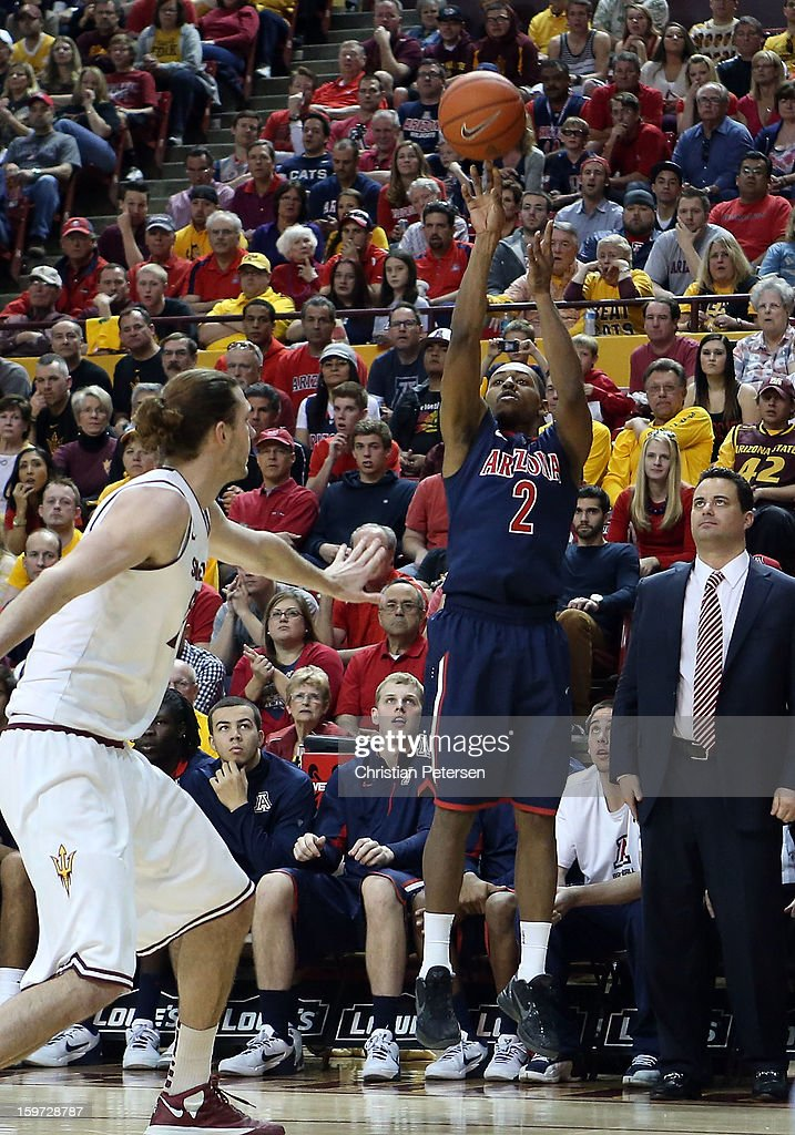 Mark Lyons #2 of the Arizona Wildcats puts up a three point shot against the Arizona State Sun Devils during the seconed half of the college basketball game at Wells Fargo Arena on January 19, 2013 in Tempe, Arizona. The Wildcats defeated the Sun Devils 71-54.