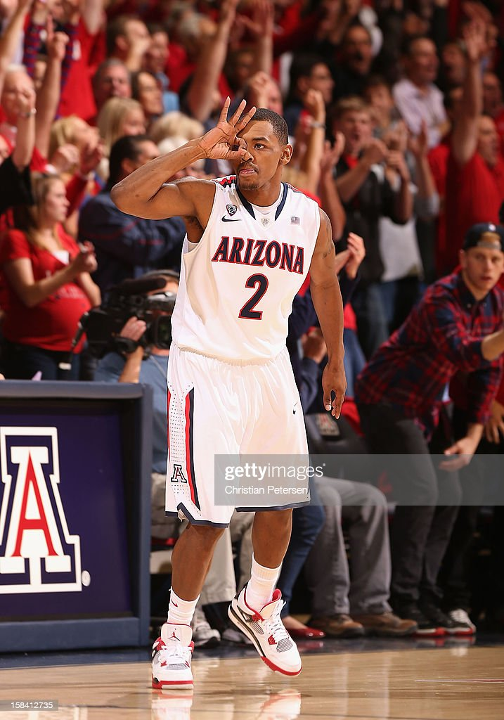 Mark Lyons #2 of the Arizona Wildcats reacts after hitting a three point shot against the Florida Gators during the first half of the college basketball game at McKale Center on December 15, 2012 in Tucson, Arizona. The Wildcats defeated the Gators 65-64.