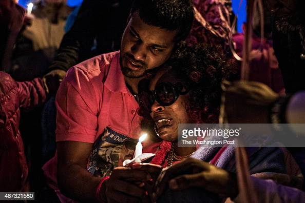 Mark Maraj left and Destiny Barnes right attend a candlelight vigil for their daughter Dynesti Maraj who was struck Saturday by a car and killed in...