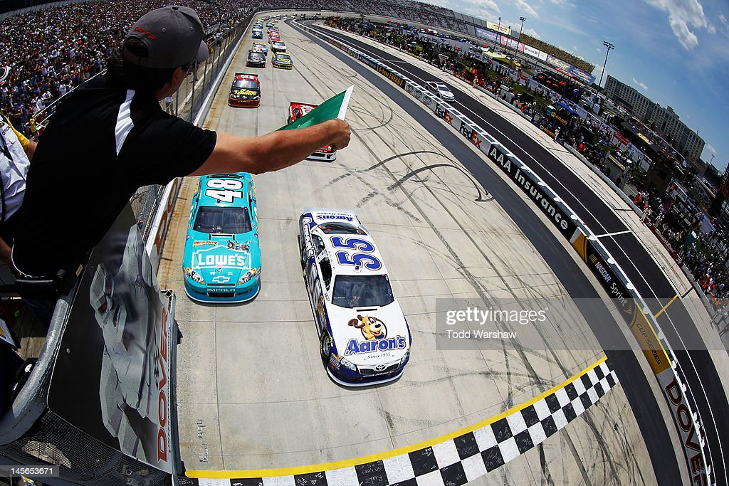 <a gi-track='captionPersonalityLinkClicked' href=/galleries/search?phrase=Mark+Martin&family=editorial&specificpeople=204455 ng-click='$event.stopPropagation()'>Mark Martin</a>, driver of the #55 Aaron's Dream Machine Toyota, and <a gi-track='captionPersonalityLinkClicked' href=/galleries/search?phrase=Jimmie+Johnson+-+Nascar+Race+Driver&family=editorial&specificpeople=171519 ng-click='$event.stopPropagation()'>Jimmie Johnson</a>, driver of the #48 Lowe's Madagascar Chevrolet, lead the field to the green flag to start the NASCAR Sprint Cup Series FedEx 400 benefiting Autism Speaks at Dover International Speedway on June 3, 2012 in Dover, Delaware.