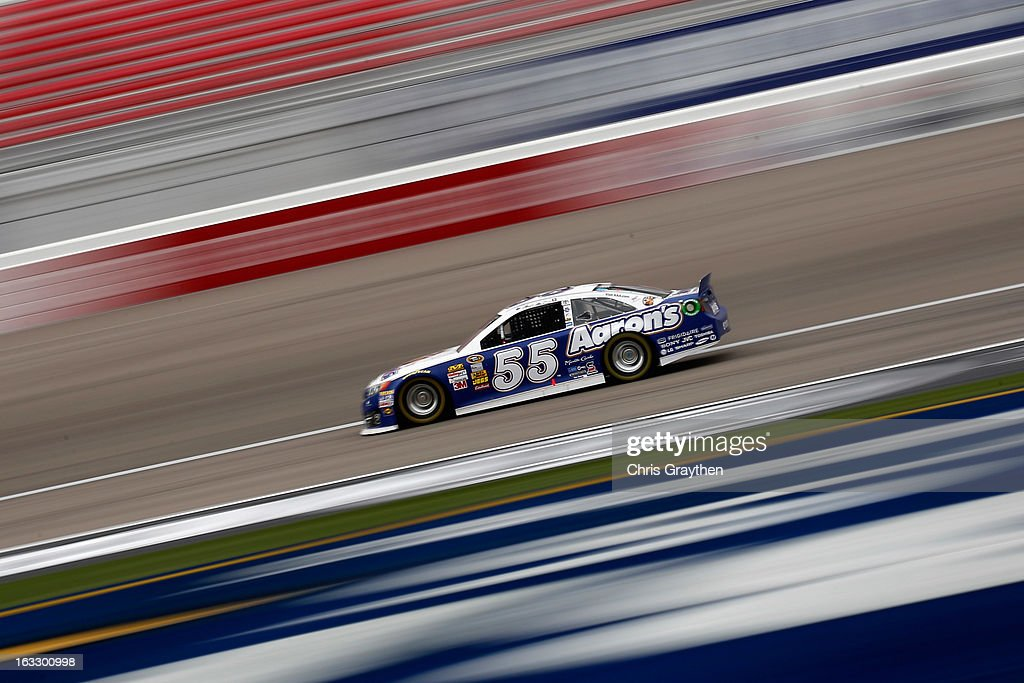<a gi-track='captionPersonalityLinkClicked' href=/galleries/search?phrase=Mark+Martin&family=editorial&specificpeople=204455 ng-click='$event.stopPropagation()'>Mark Martin</a>, driver of the #55 Aarons Dream Machine Toyota drives during NASCAR Sprint Cup Series testing at Las Vegas Motor Speedway on March 7, 2013 in Las Vegas, Nevada.
