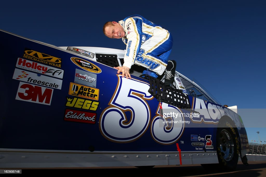 <a gi-track='captionPersonalityLinkClicked' href=/galleries/search?phrase=Mark+Martin&family=editorial&specificpeople=204455 ng-click='$event.stopPropagation()'>Mark Martin</a>, driver of the #55 Aaron's Dream Machine Toyota, gets into his car on the grid during qualifying for the NASCAR Sprint Cup Series Subway Fresh Fit 500 at Phoenix International Raceway on March 1, 2013 in Avondale, Arizona.