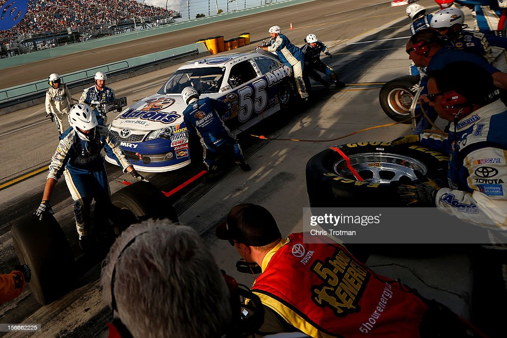 Mark Martin, driver of the #55 Aaron's Dream Machine Toyota, pits during the NASCAR Sprint Cup Series Ford EcoBoost 400 at Homestead-Miami Speedway on November 18, 2012 in Homestead, Florida.