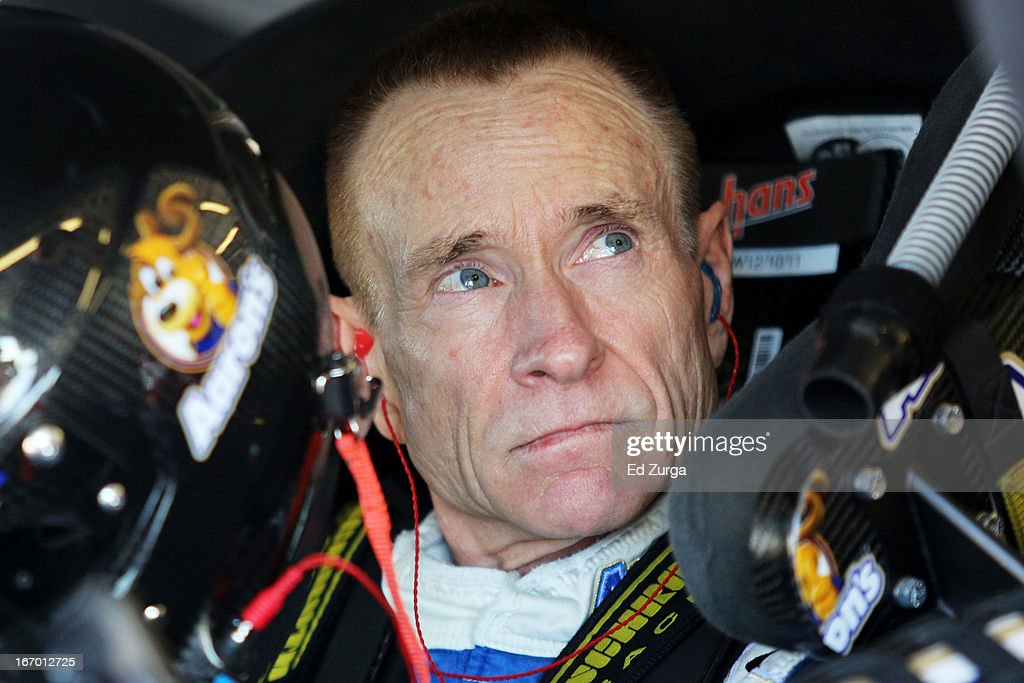 Mark Martin, driver of the #55 Aaron's Dream Machine Toyota, sits in his car in the garage area during practice for the NASCAR Sprint Cup Series STP 400 at Kansas Speedway on April 19, 2013 in Kansas City, Kansas.