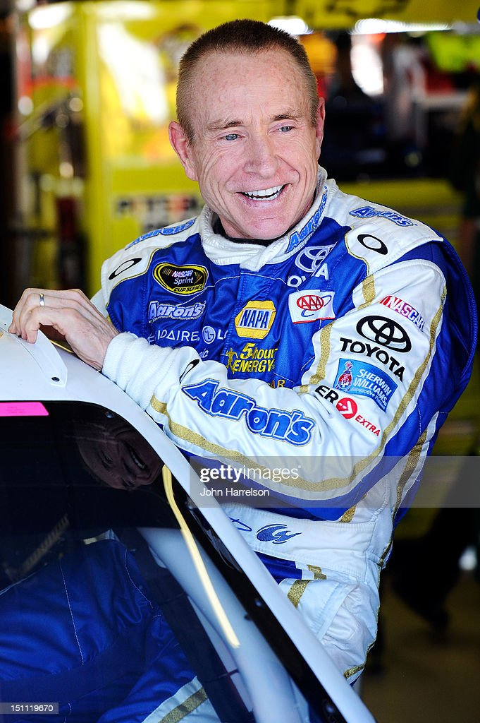 <a gi-track='captionPersonalityLinkClicked' href=/galleries/search?phrase=Mark+Martin&family=editorial&specificpeople=204455 ng-click='$event.stopPropagation()'>Mark Martin</a>, driver of the #55 Aaron's Dream Machine Toyota, smiles as he climbs into his car in the garage during practice for the NASCAR Sprint Cup Series AdvoCare 500 at Atlanta Motor Speedway on September 1, 2012 in Hampton, Georgia.