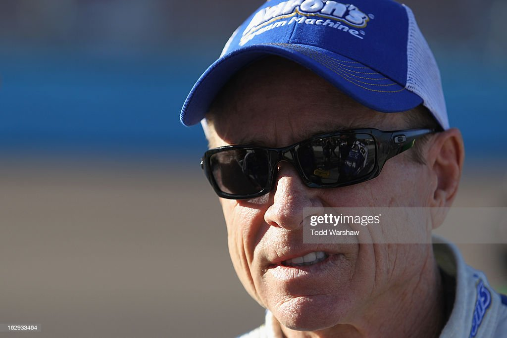 Mark Martin, driver of the #55 Aaron's Dream Machine Toyota, stands by his car during qualifying for the NASCAR Sprint Cup Series Subway Fresh Fit 500 at Phoenix International Raceway on March 1, 2013 in Avondale, Arizona.