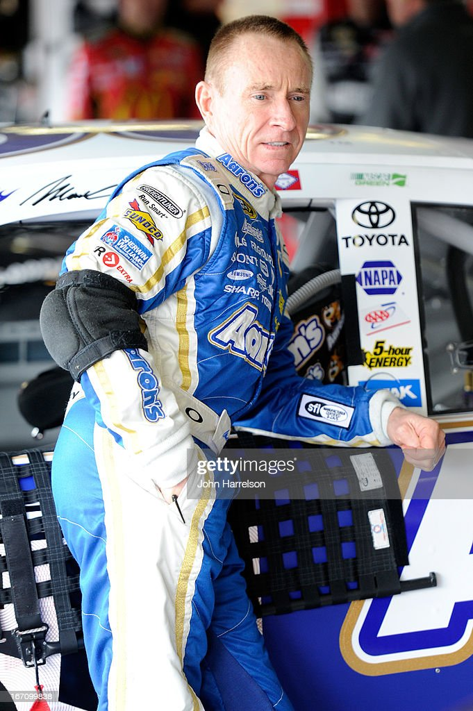Mark Martin, driver of the #55 Aaron's Dream Machine Toyota, stands in the garage during practice for the NASCAR Sprint Cup Series STP 400 at Kansas Speedway on April 20, 2013 in Kansas City, Kansas.
