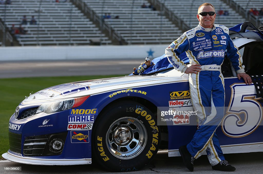 <a gi-track='captionPersonalityLinkClicked' href=/galleries/search?phrase=Mark+Martin&family=editorial&specificpeople=204455 ng-click='$event.stopPropagation()'>Mark Martin</a>, driver of the #55 Aaron's Dream Machine Toyota, stands on the grid during qualifying for the NASCAR Sprint Cup Series NRA 500 at Texas Motor Speedway on April 12, 2013 in Fort Worth, Texas.