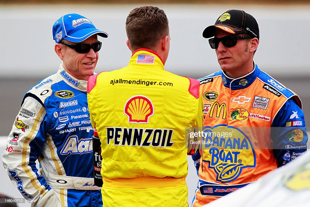 <a gi-track='captionPersonalityLinkClicked' href=/galleries/search?phrase=Mark+Martin&family=editorial&specificpeople=204455 ng-click='$event.stopPropagation()'>Mark Martin</a>,(L) driver of the #55 Aaron's Dream Machine Toyota, talks with AJ Allmendinger,(C) driver of the #22 Shell/Pennzoil Dodge, and <a gi-track='captionPersonalityLinkClicked' href=/galleries/search?phrase=Jamie+McMurray&family=editorial&specificpeople=198964 ng-click='$event.stopPropagation()'>Jamie McMurray</a>, (R) driver of the #1 Banana Boat Chevrolet, on the grid during qualifying for the NASCAR Sprint Cup Series Pocono 400 presented by #NASCAR at Pocono Raceway on June 9, 2012 in Long Pond, Pennsylvania.