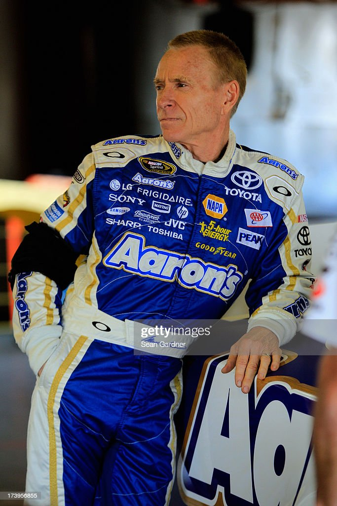 <a gi-track='captionPersonalityLinkClicked' href=/galleries/search?phrase=Mark+Martin&family=editorial&specificpeople=204455 ng-click='$event.stopPropagation()'>Mark Martin</a>, driver of the #55 Aaron's Dream Machine Toyota, waits in the garage during practice for the NASCAR Sprint Cup Series Quicken Loans 400 at Michigan International Speedway on June 15, 2013 in Brooklyn, Michigan.