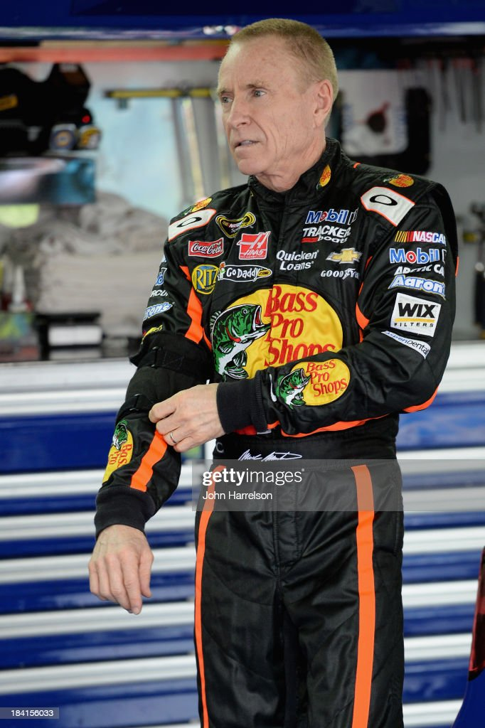Mark Martin, driver of the #14 Bass Pro Shops / Mobil 1 Chevrolet, adjusts his equipment in the garage area during practice for the NASCAR Sprint Cup Series Bank of America 500 at Charlotte Motor Speedway on October 11, 2013 in Concord, North Carolina.