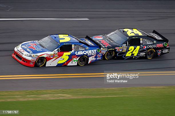 Mark Martin driver of the Carquest/GoDaddycom Chevrolet and Jeff Gordon driver of the Pepsi Max Chevrolet bump draft as they race during the NASCAR...