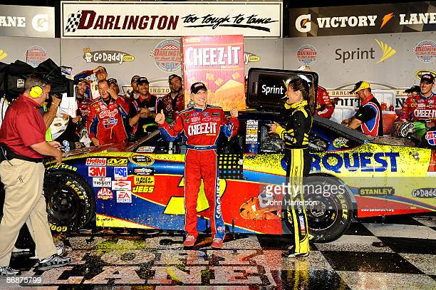 Mark Martin driver of the CheezIt/CARQUEST Chevrolet celebrates in victory lane after winning the NASCAR Sprint Cup Series Southern 500 on May 9 2009...