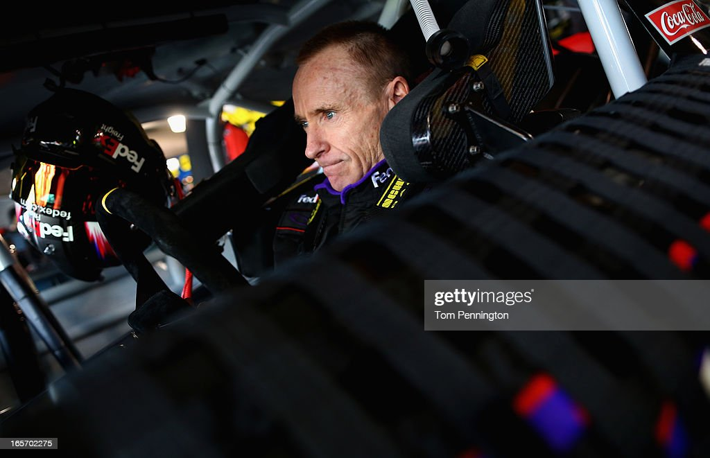 Mark Martin, driver of the #11 FedEx Freight Toyota, prepares practice for the NASCAR Sprint Cup Series STP Gas Booster 500 on April 5, 2013 at Martinsville Speedway in Ridgeway, Virginia.