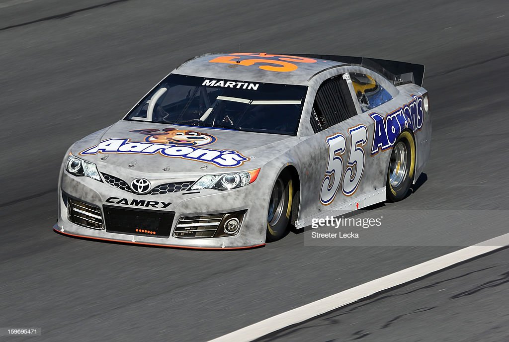 Mark Martin, driver of the #55 Michael Waltrip Racing Toyota, in action during NASCAR Testing at Charlotte Motor Speedway on January 18, 2013 in Charlotte, North Carolina.