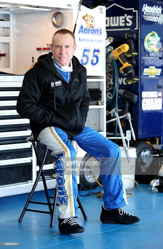 Mark Martin, driver of the #55 Michael Waltrip Racing Toyota, sits in the garage during NASCAR Testing at Charlotte Motor Speedway on January 18, 2013 in Charlotte, North Carolina.
