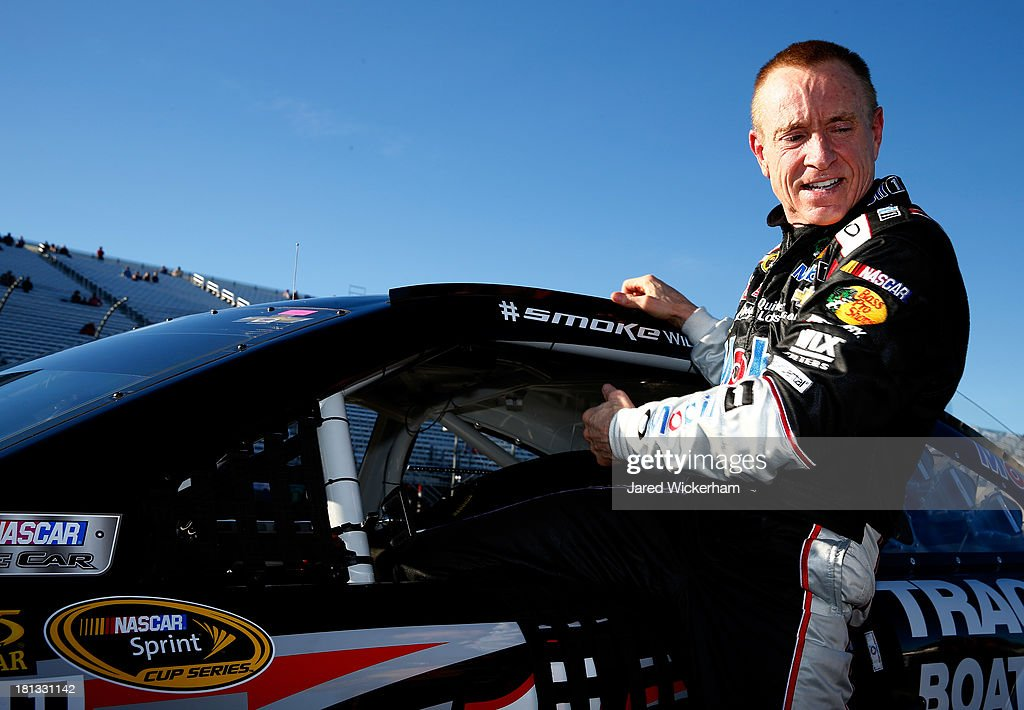 <a gi-track='captionPersonalityLinkClicked' href=/galleries/search?phrase=Mark+Martin&family=editorial&specificpeople=204455 ng-click='$event.stopPropagation()'>Mark Martin</a>, driver of the #14 Mobil 1 / Bass Pro Shops Chevrolet, climbs from his car after qualifying for the NASCAR Sprint Cup Series Sylvania 300 at New Hampshire Motor Speedway on September 20, 2013 in Loudon, New Hampshire.