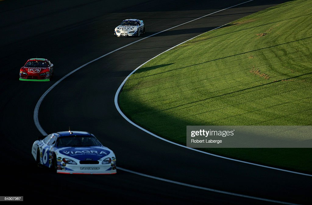 Mark Martin driver of the Roush Racing Viagra Ford leads Jeremy Mayfield in his Evernham Motorsports Dodge Dealers/ UAW Dodge and Ryan Newman in his...
