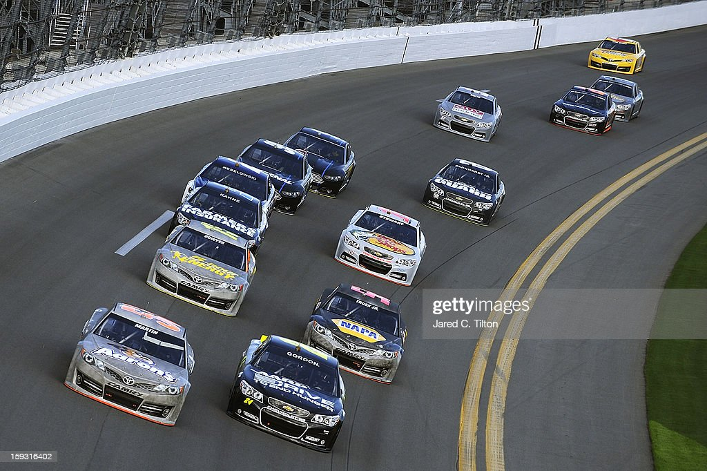 Mark Martin, driver of the #55 Toyota, and Jeff Gordon, driver of the #24 Chevrolet, lead a group of cars through the tri-oval during NASCAR Sprint Cup Series Preseason Thunder testing at Daytona International Speedway on January 11, 2013 in Daytona Beach, Florida.