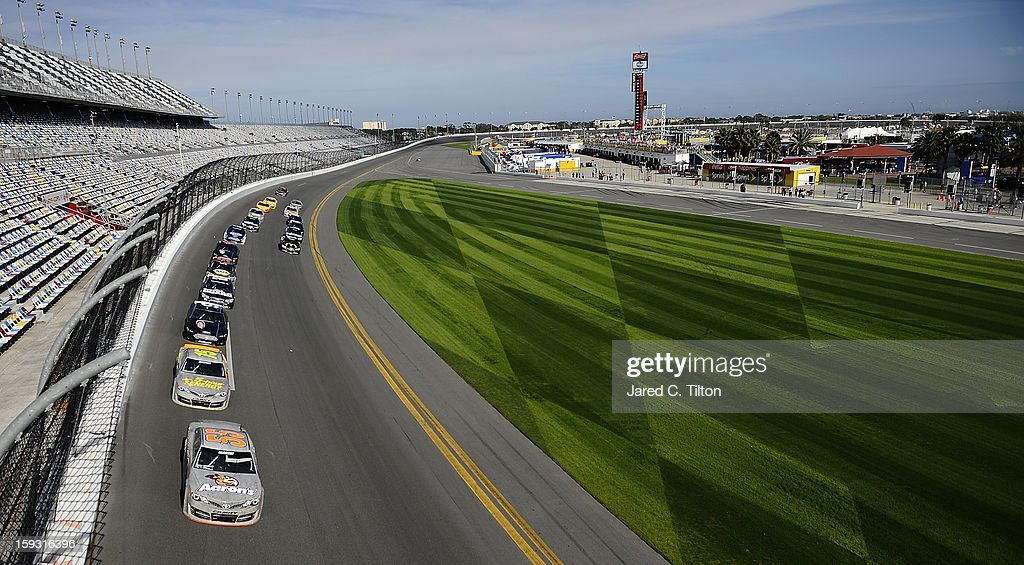 Mark Martin, driver of the #55 Toyota, leads a group of cars through the tri-oval during NASCAR Sprint Cup Series Preseason Thunder testing at Daytona International Speedway on January 11, 2013 in Daytona Beach, Florida.