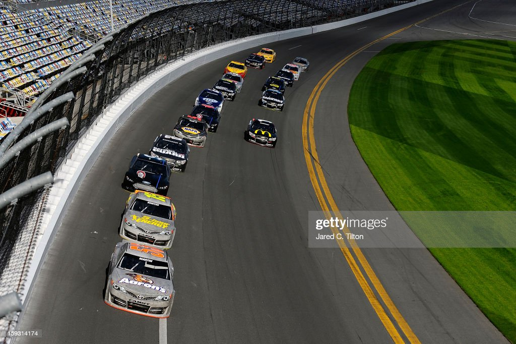 Mark Martin, driver of the #55 Toyota, leads a pack of cars through the tri-oval during NASCAR Sprint Cup Series Preseason Thunder testing at Daytona International Speedway on January 11, 2013 in Daytona Beach, Florida.