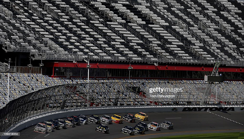 Mark Martin, driver of the #55 Toyota, leads the field during the NASCAR Sprint Cup Preseason Thunder testing at Daytona International Speedway on January 11, 2013 in Daytona Beach, Florida.