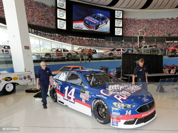 Mark Martin NASCAR Hall of Famer and Clint Bowyer driver of the Ford Fusion for StewartHaas Racing unveil the race car during the Darlington...