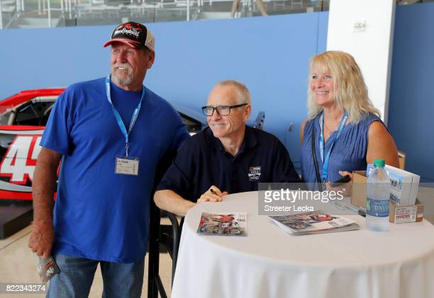 Mark Martin NASCAR Hall of Famer signs poses for pictures with fans during the Darlington Throwback Paint Scheme Unveil at NASCAR Hall of Fame on...